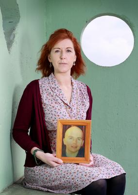Aisling Reid with a photo of her cousin Karl Robertson, who was killed in a hit-and-run in 2017.