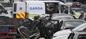 Gardai search a scrapyard as part of the operation in Finglas