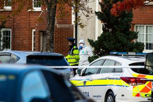 Gardaí and forensics officers at scene in Ballinteer