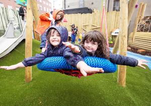 Hannah Grouden (4) from Athlone (centre) enjoys the swing with Theo (5) and Fred Curley (3)