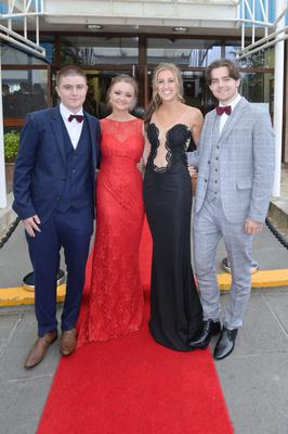 Stephen Murray (18), Aine Childs (18) wearing a dress from Maynooth, Lauren Keogh (18) wearing Coco and Sean O'Donovan (18) at the Santa Sabina Domincan College Debs.Pic: Justin Farrelly.