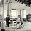 Zookeeper Patrick Supple inside the monkey house in 1913