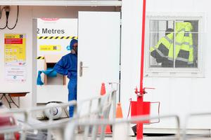 A cleaning crew and compliance officer at the site in Grangegorman after a worker tested positive for Covid-19