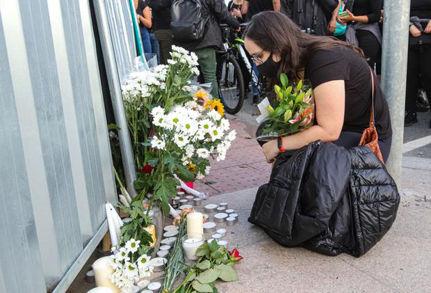 Mourners at the scene of hit-and run that killed Thiago