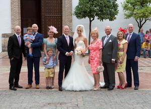 Bride and groom Peter and Debbie with their families