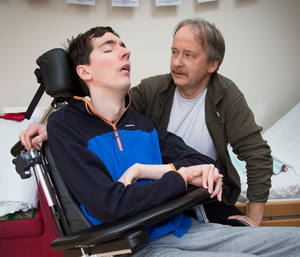Rheinhard Schaler pictured with his son Padraig (26) who suffers from a brain injury and is on a waiting list for Rehab