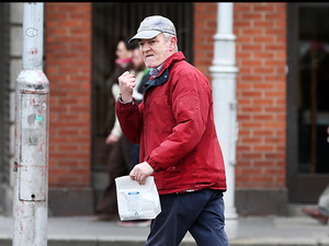 Convicted rapist Paul Moore on his way around the city, freely mingling with unaware members of the public