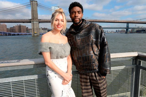 Sienna Miller and Chad Boseman pose during a photo call for 21 Bridges in New York. Photo: Brad Barket/Getty Images for STXfilms