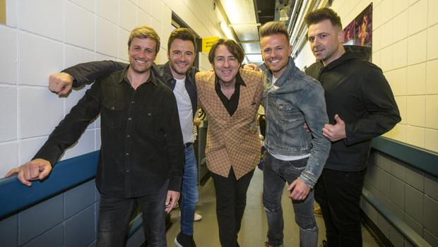 Jonathan Ross met Westlife backstage in Belfast. Photo: Independent News & Media