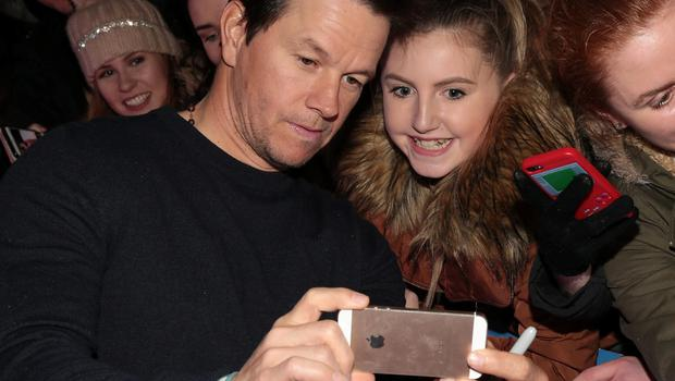 Mark Wahlberg Wahlberg takes a selfie with a fan outside the Savoy