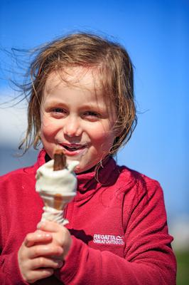 Kerenza Barry (5) from Sutton enjoying a cone in Howth this week. The good weather could continue into the summer
