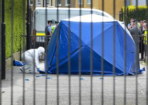Garda forensics officers in the laneway beside the Church of Our Lady Immaculate school in Darndale, where dad Jordan Davis was shot dead shortly before 4pm on May 22