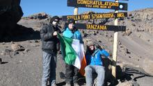 17-year-old Cystic Fibrosis sufferer Shane Dunphy (centre) on the summit of Kilimanjaro with his best friends Neil Mockler and Jack Hennessy, who supported him all the way, raising money and awareness about CF and accompanying him on the climb