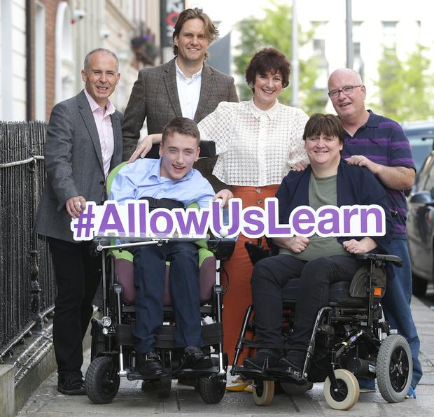 Back row from left: Inclusion Ireland's Mark O'Connor, the Central Remedial Clinic's Ben Henricksen, Disability Federation Ireland's Clare Cronin and Ciaran Costello, from Westmeath. Front row: Conor Dillon and Joan Carthy, of the Irish Wheelchair Association. Photo: Damien Eagers/INM