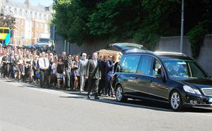 Family and friends walk with the remains of Berkeley victim Eoghan Culligan. Photo: Gareth Chaney Collins