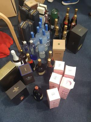 Dozens of bottles of high-end alcohol were seized, along with documentation, devices and €30,000 in cash