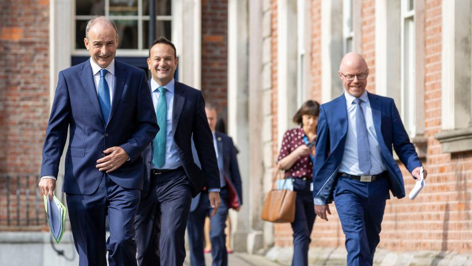 The Taoiseach, Tánaiste and Health Minister arriving at the unveiling of the 'Living with Covid' plan in September