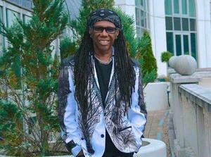Nile Rodgers wearing one of Claire Garvey's designed jackets
