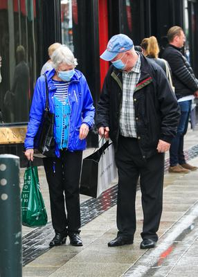Shoppers wearing masks in the city centre yesterday