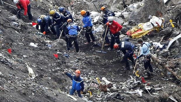 rescue workers work on debris of the Germanwings jet at the crash site near Seyne-les-Alpes, France.