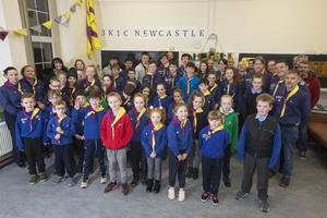 Scouts and parents from the 3K1C Newcastle Scout Group, who say losing the den will be 'devastating' for the community