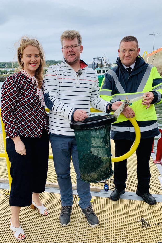 Rowan Byrne with Harbour master Harry Mcloughlan and Senator Catherine Noone