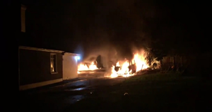 Vehicles burn at the property after the attack. Picture: The Democrat, Roscommon