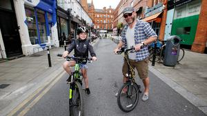 Evie Brown (8) and dad Justin, from Dublin, enjoy a pedestrianised Drury Street in the city
