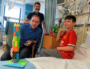 Pictured are Republic of Ireland manager Martin O'Neill with assistant manager Roy Keane and Adam Farrell, age 10 from Dunboyne, Co. Meath