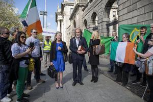Gemma O'Doherty and John Waters outside court