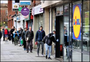 Shoppers queue in Rathmines after lockdown restrictions were announced