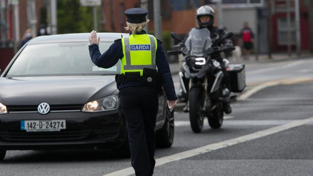 Gardai stop drivers at a Covid-19 checkpoint on the North Strand