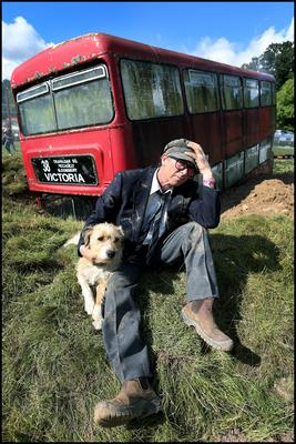 Getting ready for the Electric Picnic at Stradbally Co Laois at 'The Bus that fell to Earth' was Dave Sumray from Kilmore Quay Co. Wexford with his dog Rufus.