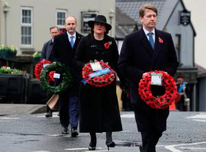 Northern Ireland First Minister Arlene  Foster with Minister of State Robin Walker and Taoiseach Micheál Martin during a  Remembrance Sunday service in Enniskillen. Photo: Brian Lawless/PA Wire