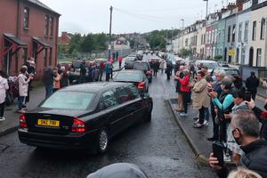 The funeral cortege of the former SDLP leader John Hume leaves St Eugene's Cathedral in Londonderry following his funeral service