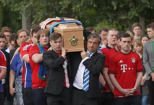 Father and brother, John and Alexei carry the coffin to the Church of the Three Patrons, Rathgar for the funeral mass of Niccolai Schuster.