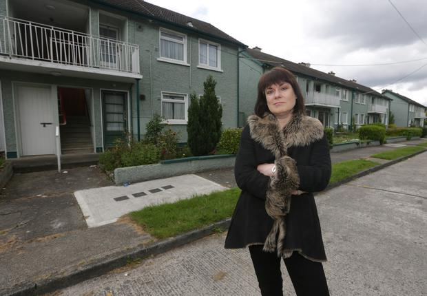 Councillor Deirdre Donnelly in St Laurence's Park, Stillorgan, where the council may demolish 16 maisonettes to make way for a replacement for the Glenalbyn swimming pool