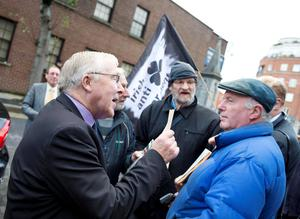 The Lord Mayor of Dublin, Christy Burke faces protestors of The Irish Anti-war movement and Bill O'Brien, as he arrives at the National Cathedral and Collegiate Church of St. Patrick's Remembrance Sunday.