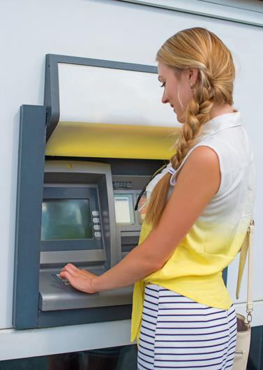 Woman using ATM (Stock picture)