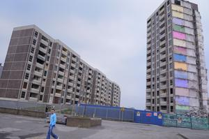 Billionaire businessman Dermot Desmond told the Housing Minister the project will be 'higher than the density of Ballymun Towers' (pictured), which have now been demolished