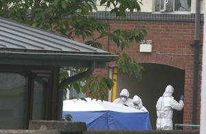 Garda forensics officers at the scene of the fatal stabbing in St Lawrence Road, Clontarf