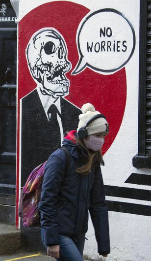 People walk in Temple Bar pictured in Dublin during the Level 5 Covid-19 Restrictions