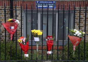 Floral tributes outside the flats where Gareth Hutch was shot