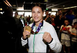 Irish boxer Katie Taylor who won gold at the Women's Lightweight Championship at the European Games in Baku at the weekend returning to Dublin Airport.