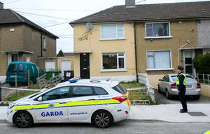 Gardai at the scene of the shooting on Cappagh Drive