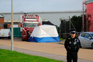 Police at the scene in Essex where the 39 bodies were found. Photo: PA