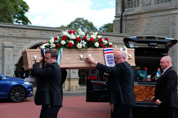 Jack Charlton's coffin is carried to the church in Ashington