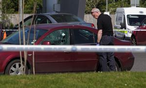 Gardaí at the scene on Clonshaugh Road where James 'Mago' Gately was shot