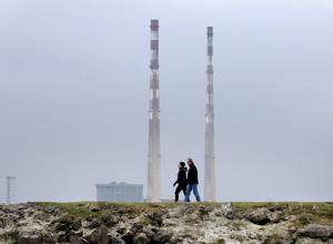 A couple walk at the North Bull beside Dollymount Strand. Photo: Frank McGrath