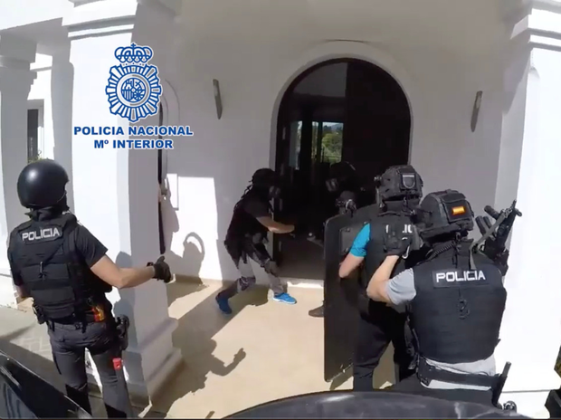 Footage showing the officers smashing down the doors of the luxury mansion